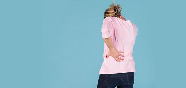 صورة وجع الظهر من اعراض الحمل , انتى حامل لو عندك الاعراض دي 3243 2